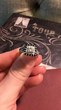 silver-colored ring with black gemstone
