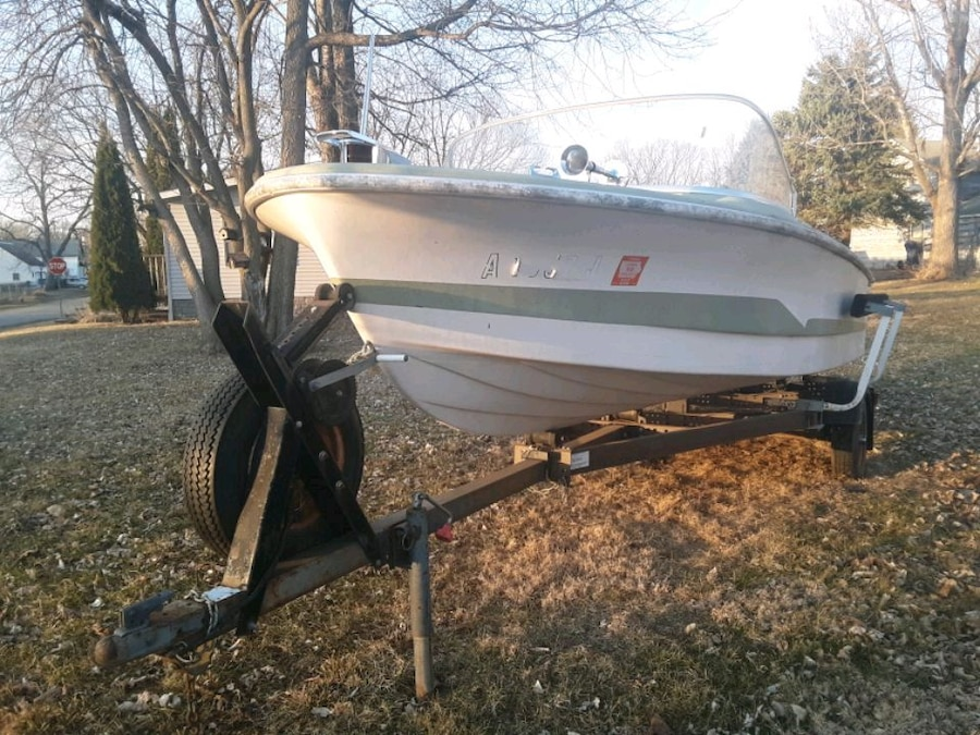 Photo Boat and trailer looking to trade for motorcycles