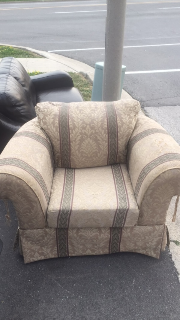 Brown and beige floral fabric sofa chair