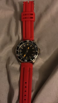 Round black face analog watch with red rubber strap Big Rapids, 49307