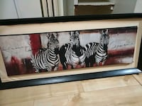 three Zebra paintings with black wooden frame
