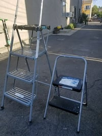 two gray metal folding chairs Los Angeles, 91402