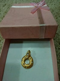 gold-colored pendant from The Bay. Box included.