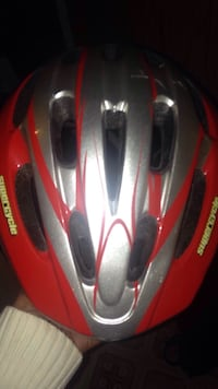 red and gray Bell bicycle helmet Calgary, T3J 2A8