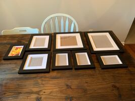 Gallery wall frames and sign
