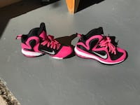 Size 6y or 7.5 women pair of pink-and-black Nike basketball shoes