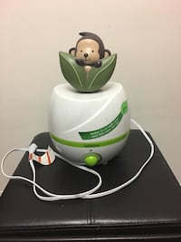 Baby's white and green humidifier  540 km