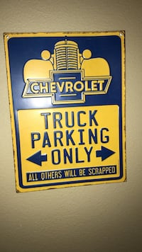 blue and yellow Chevrolet truck parking only signage Bartlesville, 74006