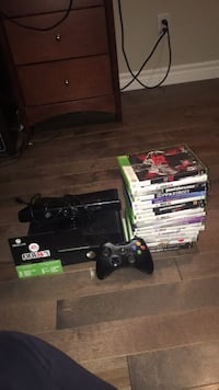 Black xbox 360 console with two controller and games Laval, H7M 5J5