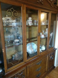 brown wooden framed glass display cabinet Toronto, M4L 2P5
