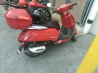 red and black motor scooter Gadsden, 35903