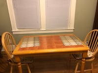 Moving sale, kitchen table with two chairs and cushions   Garwood