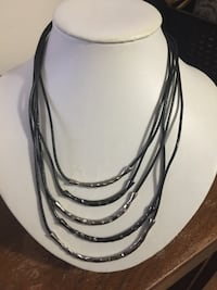 NEW. Black necklace with metal accent multi-strand