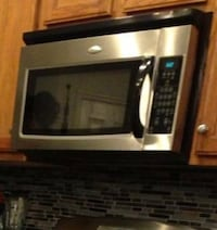 Black and stainless steel microwave oven Ashburn, 20148