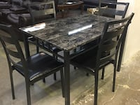 Dining table with 4 chairs. Brand new.  Farmers Branch, 75234