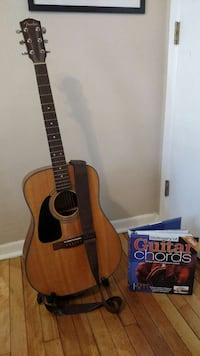 Left handed guitar with stand and book Saint Paul