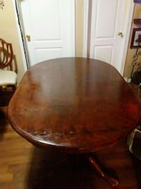 round brown wooden dining table 548 km