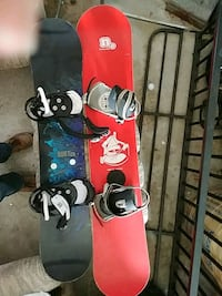 two red and black snowboards with bindings Thornton, L0L 2N0