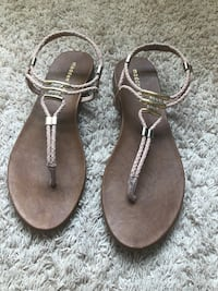 pair of brown leather thong sandals Fairfax