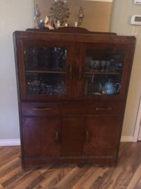 brown wooden cabinet with shelf Airdrie, T4A 2A3