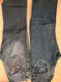 Two pairs of blue denim jeans