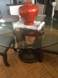 round glass top table with brown wooden base Toronto, M9R 1R7