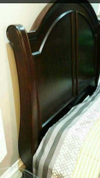 Stained solid wood head board