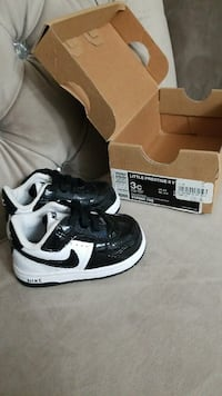 pair of white-and-black Nike shoes with box