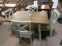 rectangular brown wooden table with four chairs Lafayette, 70501