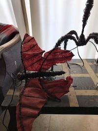 red and black butterfly lite and standing matching artist lite Miami, 33173