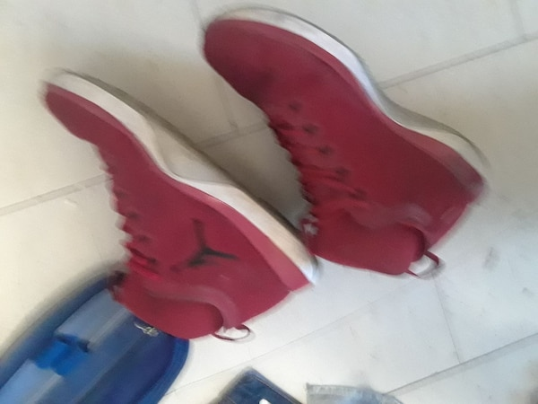 red Air Jordan basketball shoes
