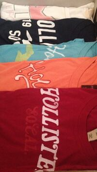 five assorted color crew neck shirts