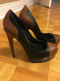 pair of women's brown-and-black leather closed-toe pumps