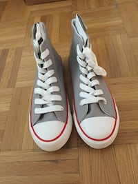 pair of white Converse All Star low-top sneakers