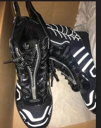 pair of black-and-white basketball shoes with box