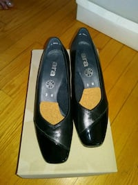 pair of black leather shoes  Gatineau, J9H 7G8