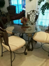 round glass top table with four chairs dining set Orlando