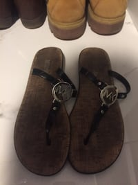 pair of brown leather sandals Surrey