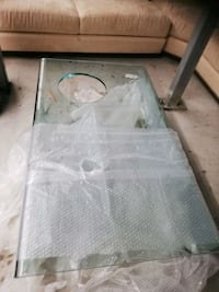 Georgeous waterfall style thick glass coffee table and side table.