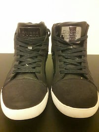 pair of black Guess high-top sneakers