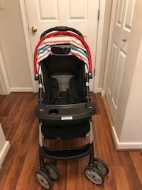 baby's black and red stroller 25 km