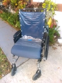 Wheelchair w/ extra tip over wheels on the back Deltona, 32738