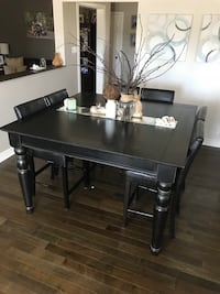 Black antique wooden table with 8 chairs St Catharines, L2T 4A6