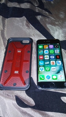 Space gray iPhone 6 with red and black case