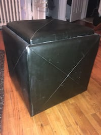 2 black leather ottomans