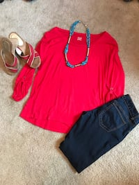 women's red scoop neck shirt, blue jeans and pair of brown pumps