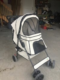 white and black pet stroller
