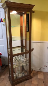 Brown wooden frame glass display cabinet Tampa, 33603