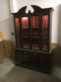 brown wooden framed glass cabinet WASHINGTON