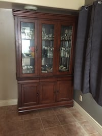 brown wooden framed glass display cabinet The Nation / La Nation